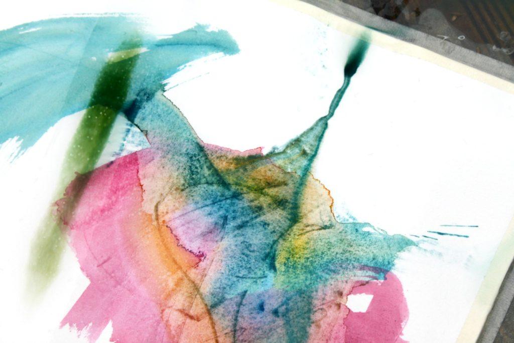 Akvarellimaalaus vesisateessa