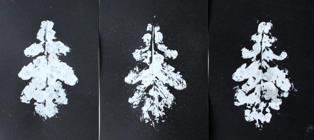 Talvisia kuusia tammenlehdellä